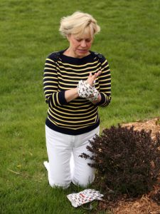 caucasian mature woman gardening with arthritis